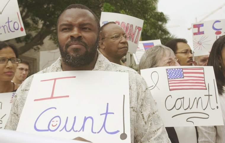 File Photo: Felon Leroy Jones joins other demonstrators outside court in Miami, Wednesday, April 9, 2003, where the 11th U.S. Circuit Court of Appeals heard arguments on whether the state is doing enough to help ex-felons restore their voting rights. ...
