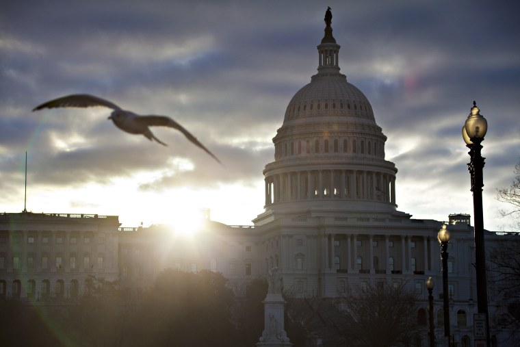 FILE – In this March 7, 2013, file photo the sun breaks through clouds over the U.S. Capitol in Washington. Daylight-saving time begins at 2 a.m. Sunday, March 10, 2013, when clocks officially move ahead an hour. (AP Photo/J. Scott Applewhite, File)