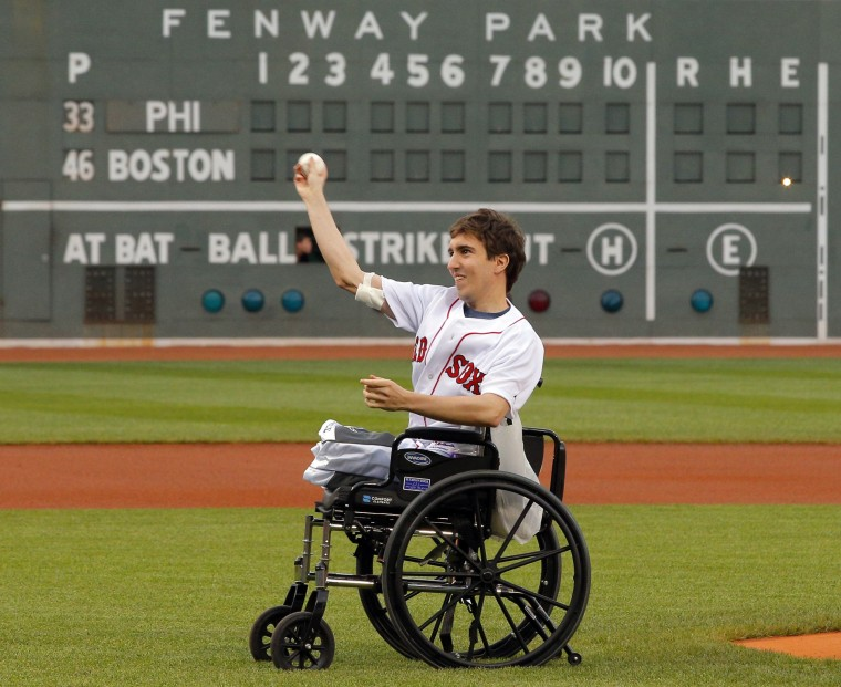 Boston Marathon survivor Jeff Bauman throws out a ceremonial first pitch before the baseball game between the Philadelphia Phillies and the Boston Red Sox at Fenway Park in Boston, Mass., on May 28, 2013. (REUTERS/Brian Snyder)