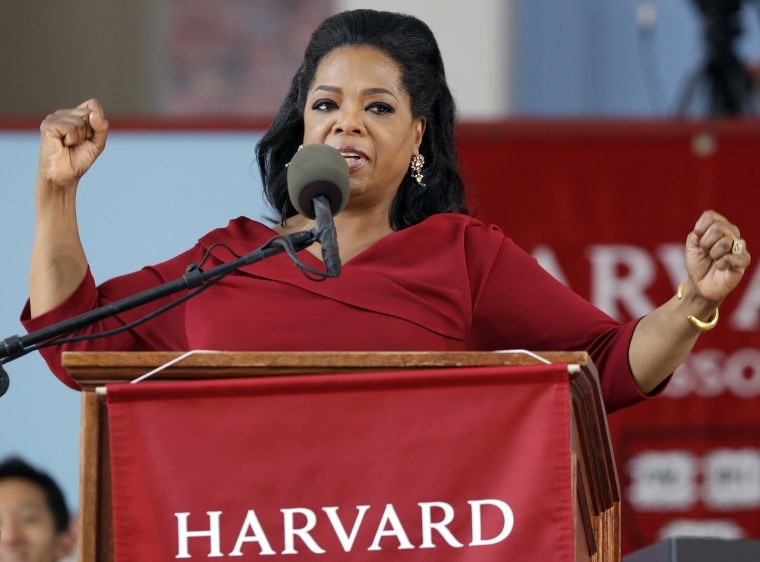 Oprah Winfrey receives honorary degree from Harvard University during commencement ceremonies in Cambridge, Mass., Thursday, May 30, 2013. (AP Photo/Elise Amendola)