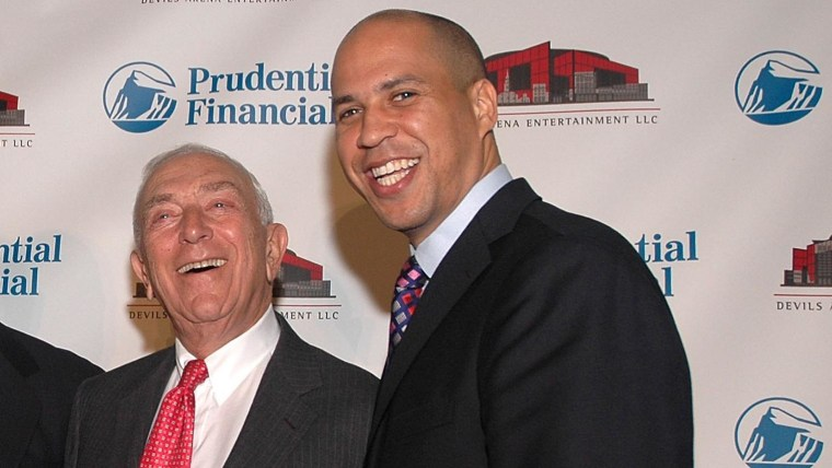 Senator Frank Lautenberg (2nd R)) and Mayor of Newark Cory A. Booker pose for photos prior to the news conference between Prudential Financial and Devils Arena Entertainment naming the Prudential Center as the new home of the New Jersey Devils on...