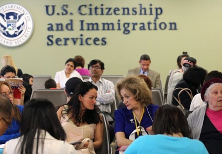 Immigrants await their turn for green card and citizenship interviews at the U.S. Citizenship and Immigration Services Queens office on May 30, 2013. (Photo by John Moore/Getty Images)