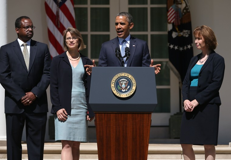 President Obama speaks while nominating Cornelia Pillard (2nd-L), a law professor, Patricia Ann Millett (R), an appellate lawyer, and Robert L. Wilkins (L),  to become federal judges, during an event in the Rose Garden of the White House June 4, 2013...