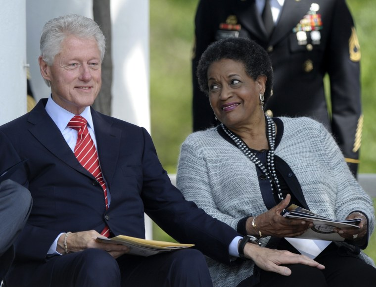 Former President Bill Clinton sits next to Myrlie Evers-Williams, the widow of slain civil rights activist Medgar Evers, during the 50th anniversary remembrance ceremony of his death, Wednesday, June 5, 2013,  at Arlington National Cemetery in...