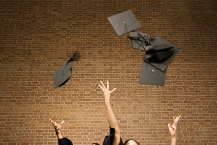 Graduates throwing their mortar boards. (Stock photo by Getty Images.)
