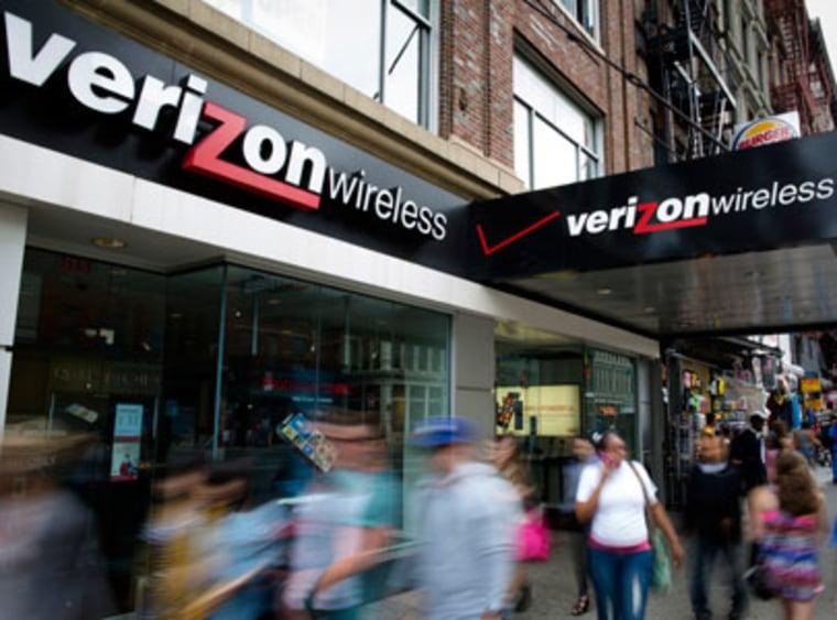 Pedestrians pass a New York City Verizon Wireless store on June 6, 2013. (Photo by John Minchillo/AP)