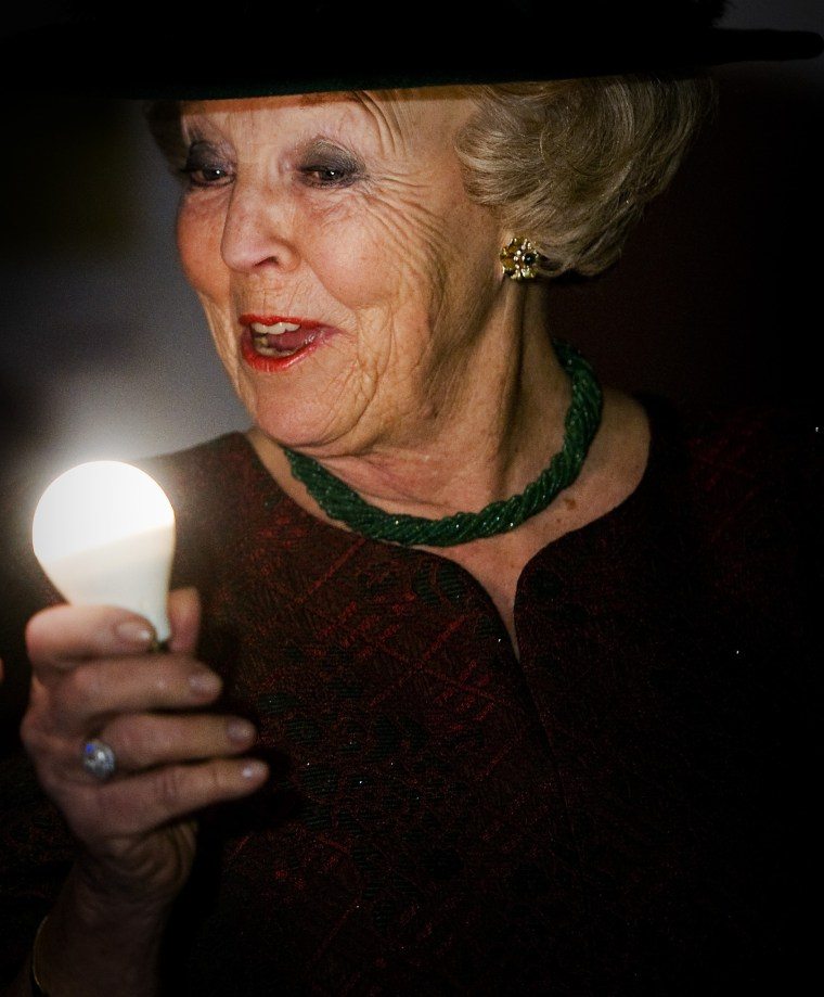 """Innovation is the """"constant"""" of our lives, New York Times Magazine editor Hugo Lindgren writes in the publication's newest issue. Dutch Queen Beatrix holds a light bulb at the opening act for the new Philips Museum in Eindhoven on April 5, 2013. (AFP..."""
