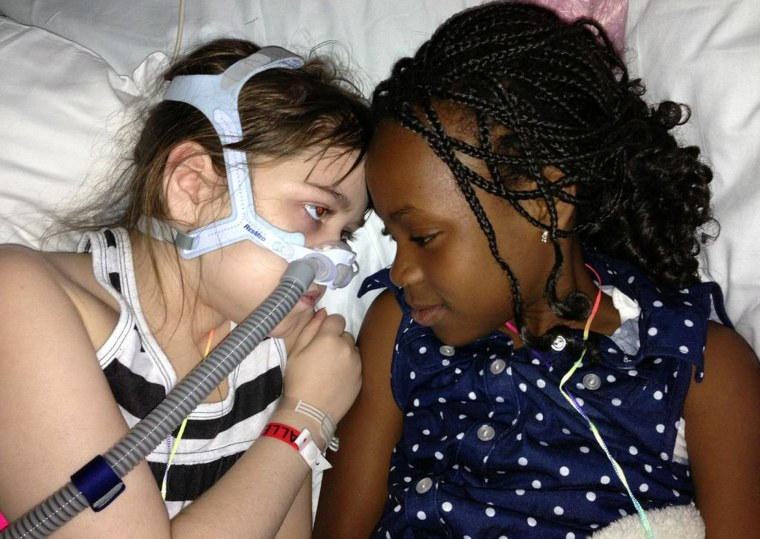 In this May 30, 2013 photo provided by the Murnaghan family, Sarah Murnaghan, left, lies in her hospital bed next to adopted sister Ella on the 100th day of her stay in Children's Hospital of Philadelphia. The 10-year-old suburban Philadelphia girl has...