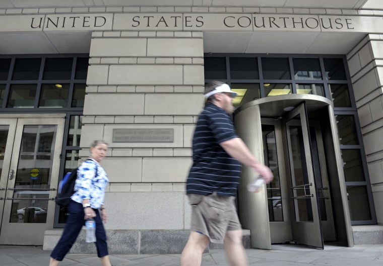 People walk in front of the U.S. Courthouse in Washington, Thursday, June 6, 2013, where the secret Foreign Intelligence Surveillance Court resides. An order was granted by the secret Foreign Intelligence Surveillance Court on April 25, good until July...