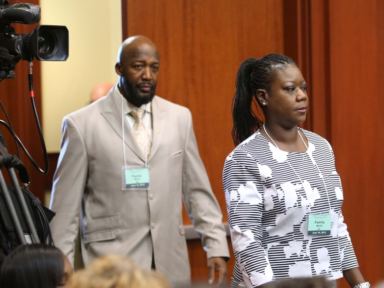 Tracy Martin, left, and Sybrina Fulton, parents of Trayvon Martin, arrive in court for the first day of the trial of George Zimmerman, in Seminole circuit court in Sanford, Fla., on June 10, 2013. (AP Photo/Orlando Sentinel, Joe Burbank/Pool)