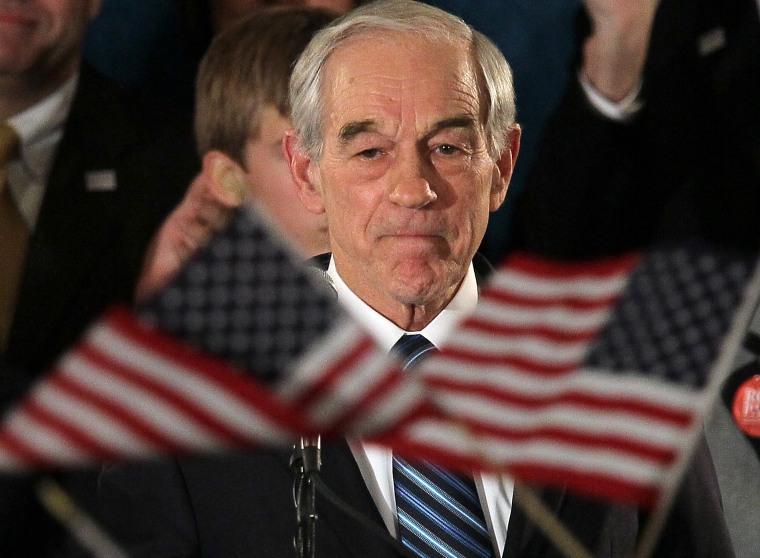 Republican presidential candidate, Texas Republican Rep. Ron Paul, peaks to supporters during a rally on the night of the Iowa caucus at the Courtyard Des Moines Ankeny on January 3, 2012 in Ankeny, Iowa.(Photo by Justin Sullivan/Getty Images)