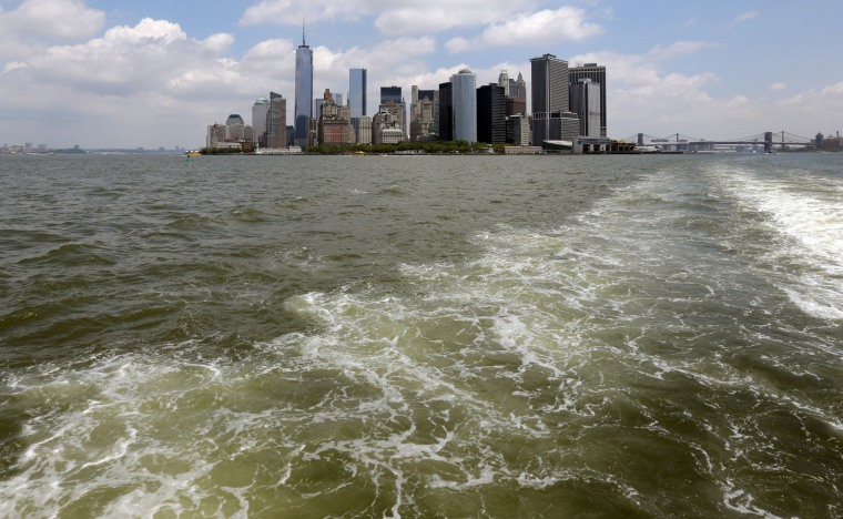 Lower Manhattan is visible from the Staten Island Ferry, in New York's Upper Bay, Tuesday, June 11, 2013. Giant removable floodwalls would be erected around lower Manhattan, and levees, gates and other defenses would be built elsewhere around the city...