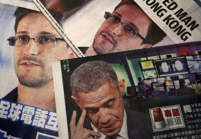 Photos of Edward Snowden, a contractor at the National Security Agency (NSA), and U.S. President Barack Obama are printed on the front pages of local English and Chinese newspapers in Hong Kong in this illustration photo June 11, 2013. (REUTERS/Bobby Yip)
