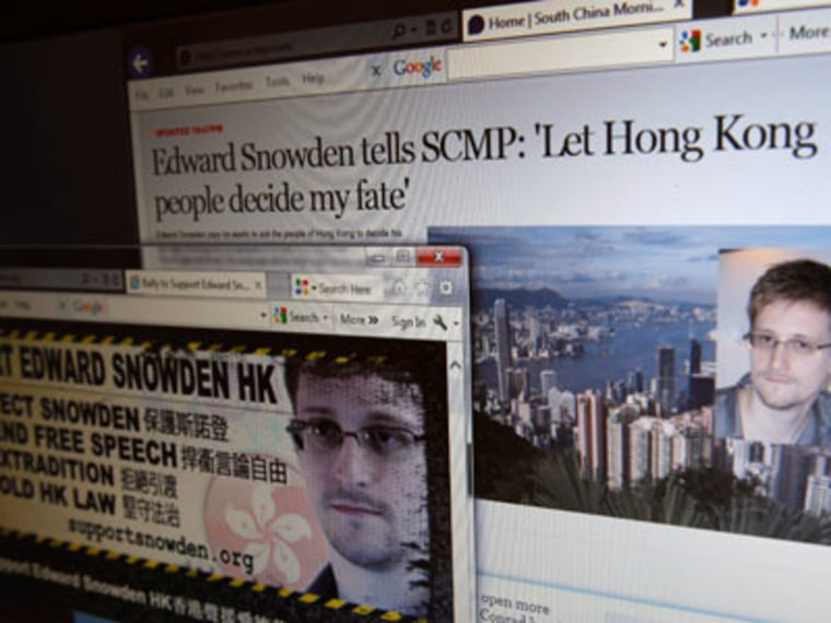 An interview of Edward Snowden by the South China Morning Post newspaper and a website supporting Snowden in Hong Kong are displayed on a computer screen in Hong Kong on June 12, 2013. (Photo by  Bobby Yip/Reuters)