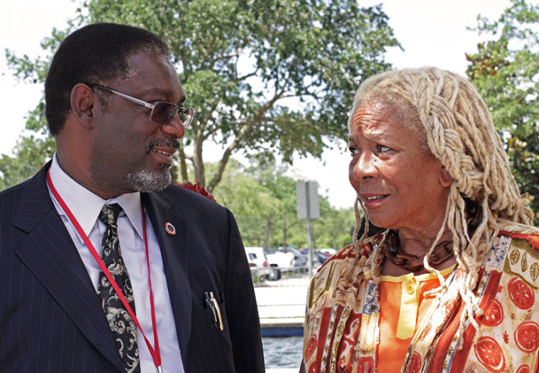 Thomas Battles (L), Southeast Regional director of the Department of Justice's Community Relations Service, talks with community activist Francis Oliver (R), outside of the Seminole County courthouse on Monday where George Zimmerman is being tried for...