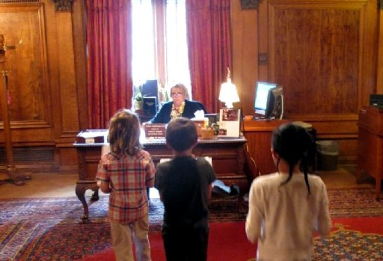 Children deliver letters written by Philadelphia public school students to the office of Gov. Tom Corbett as part of an effort organized by education groups to secure enough state aid to head off nearly 3,800 layoffs in the state's largest school...