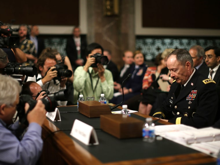 File photo: Army Gen. Keith Alexander, director of the National Security Agency (NSA) is surrounded by photographers after arriving at a Senate Appropriations Committee hearing June 12, 2013.  (Photo by Mark Wilson/Getty Images)