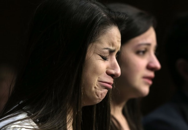 WASHINGTON, DC - FEBRUARY 27:  Sisters of Sandy Hook Elementary shooting victim first-grade teacher Victoria Soto, Jillian Soto (R) and Carlee Soto (L) listen during a hearing before the Senate Judiciary Committee February 27, 2013 in Washington, DC.  ...