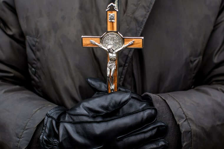 An anti-abortion protester holds a crucifix at the March for Life on January 25, 2013 in Washington, DC. The pro-life gathering is held each year around the anniversary of the Roe v. Wade Supreme Court decision. (Photo by Brendan Hoffman/Getty Images)