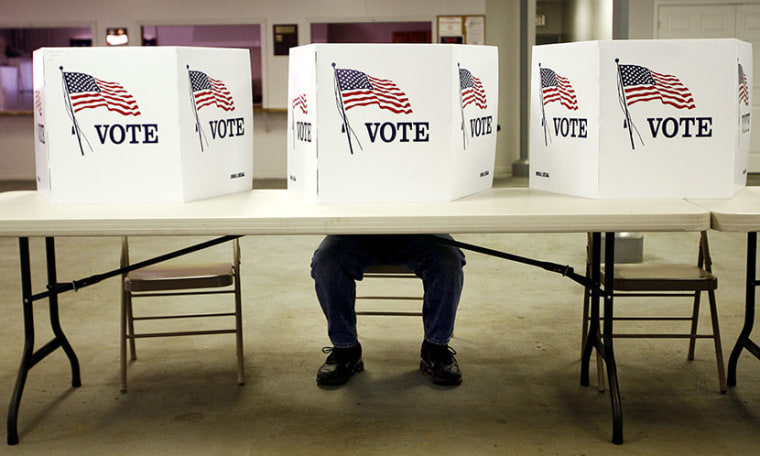 A voter casts a ballot. (Photo by Matt Sullivan/Reuters)