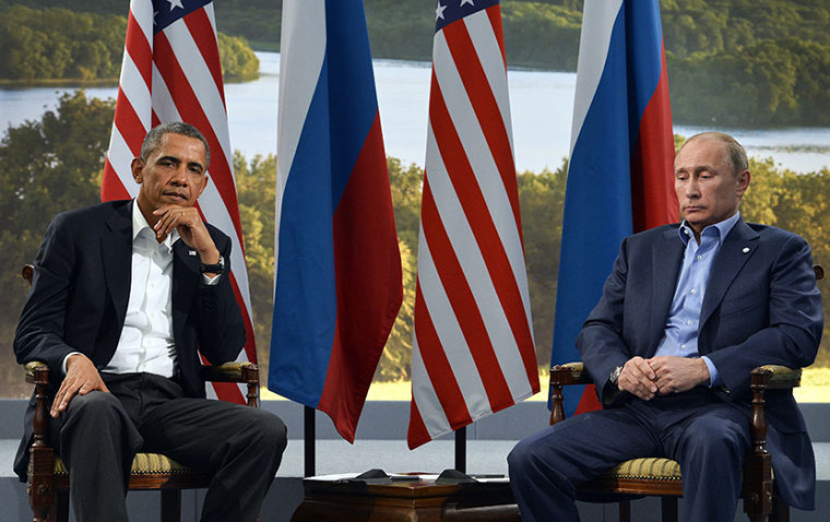 Barack Obama and Russian President Vladimir Putin during the G8 summit on June 17, 2013.   AFP PHOTO / JEWEL SAMAD        (Photo by Jewel Samad/AFP/Getty Images)
