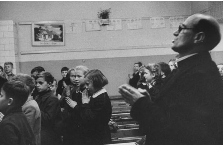 Prayer in school, 1956 (Photo by Lisa Larsen/Time Life Pictures/Getty Images).