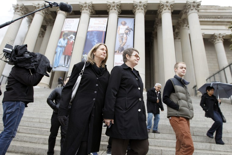 Sandy Stier, left, and Kris Perry of Berkeley, Calif., arrive at the National Archives in Washington, Monday, March 25, 2013, to view the U.S. Constitution, a day before their same-sex marriage case is heard before the Supreme Court. (AP Photo/Jose...