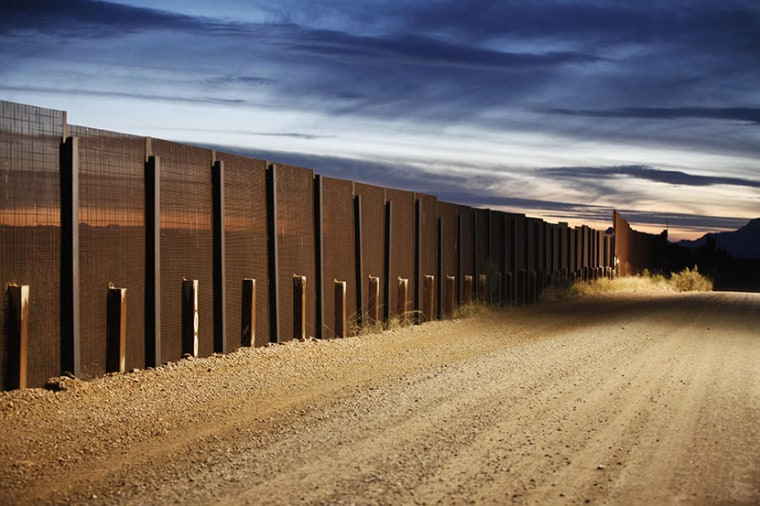 The Arizona-Mexico border fence near Naco, Arizona, March 29, 2013. (Photo by Samantha Sais/Reuters)