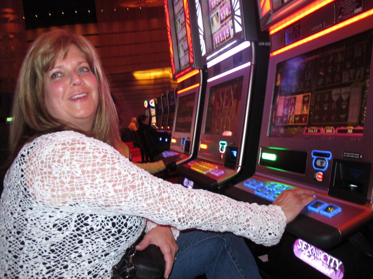 "FILE - In this May 21, 2012 file photo, Donna Kiddie of Point Pleasant Beach N.J. plays a ""Sex And The City"" slot machine at Revel in Atlantic City N.J. Revel, which is in federal bankruptcy court, posted a $110 million operating loss in the nine..."