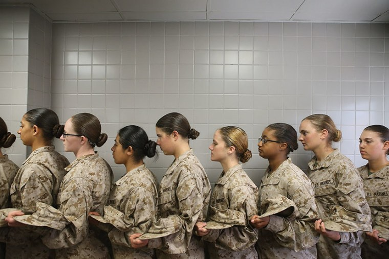 Female Marine recruits stand in line before getting lunch in the chow hall during boot camp on February 26, 2013 at MCRD Parris Island, South Carolina.  (Photo by Scott Olson/Getty Images)