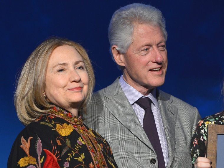 Former president Bill Clinton and former Secretary of State Hillary Clinton attend SeriousFun Children's Network event honoring Liz Robbins with celebrity guests at Pier Sixty at Chelsea Piers on April 4, 2013 in New York City.  (Photo by Larry Busacca...