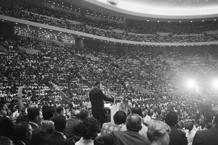 Rev. Martin Luther King Jr., speaks to an overflow crowd in Detroit's Cobo Hall Arena on Sunday, June 24, 1963, following a Freedom March.  (AP Photo)