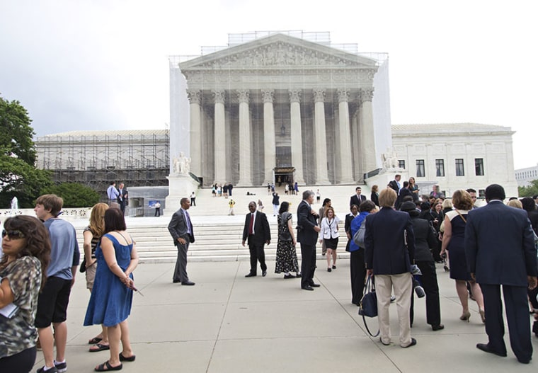 People wait outside the Supreme Court in anticipation of key decisions being announced, on Capitol Hill in Washington, Monday, June 17, 2013. (Photo by J. Scott Applewhite/AP)