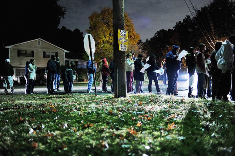 Voters wait in line near the Irondale Senior Citizens' Center, near Birmingham, Ala., Tuesday, Nov. 6, 2012. (Photo by Tamika Moore/The Birmingham News/AP)
