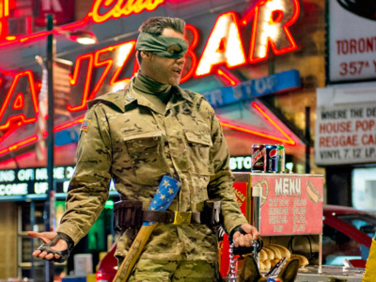 """Jim Carrey playing the role of """"Col. Stars and Stripes"""" in """"Kick-Ass 2.""""  (Photo by Daniel Smith/Universal Pictures/AP)"""
