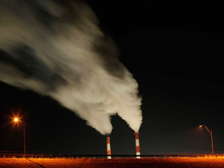 In this Jan. 19, 2012, file photo time exposure image smoke rises from the stacks of the La Cygne Generating Station coal-fired power plant in La Cygne, Kan. (Photo by Charlie Riedel/AP)