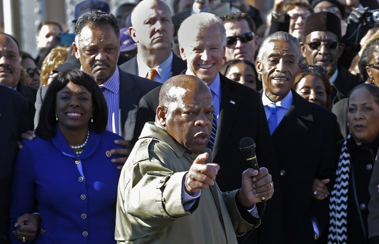 U.S. Rep. John Lewis, D-Ga., points to where he and others were beaten 48 years ago when they tried to cross the Edmund Pettus Bridge during a civil rights march in Selma, Ala., Sunday, March 3, 2013.  (AP Photo/Dave Martin)
