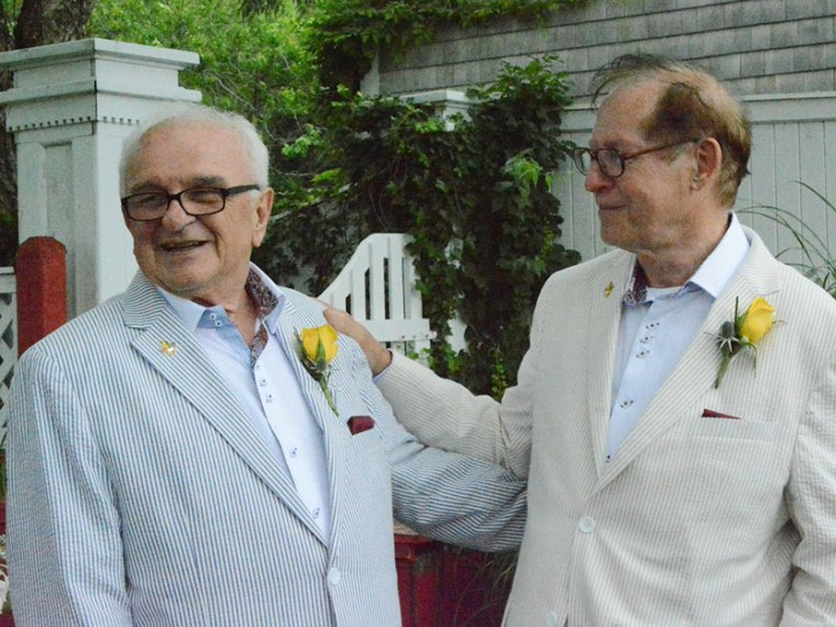 Ted-Larry Pebworth (left ) with husband Claude Summers at their wedding on June 27th.  (Courtesy of Dan McKeon)