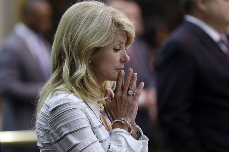 Sen. Wendy Davis, D-Fort Worth, reacts after she was called for a third and final violation in rules to end her filibuster attempt to kill an abortion bill, Tuesday, June 25, 2013, in Austin, Texas. The bill would ban abortion after 20 weeks of...