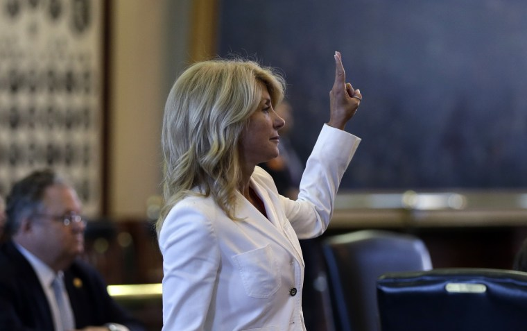 Sen. Wendy Davis, D-Fort Worth, holds up two fingers to cast a no vote to bring an abortion bill to the floor early for debate, Monday, June 24, 2013, in Austin, Texas. (AP Photo/Eric Gay)