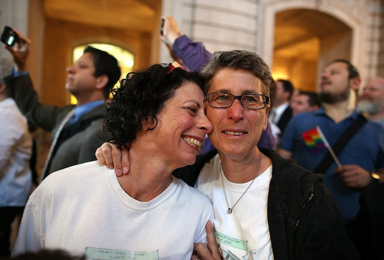Same-sex couple Sue Rochman (L) and Robin Romdalvik celebrate upon hearing the U.S. Supreme Court's rulings on gay marriage in City Hall June 26, 2013 in San Francisco, United States. The high court struck down the Defense of Marriage Act (DOMA) and...
