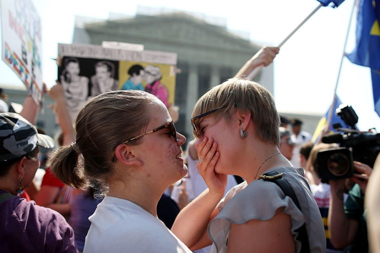 American University students Sharon Burk (L) and Mollie Wagoner (R) embrace after hearing that the U.S. Supreme Court ruled that the Defense of Marriage Act (DOMA) is unconstitutional at the Supreme Court, June 26, 2013 in Washington, DC. (Photo by...