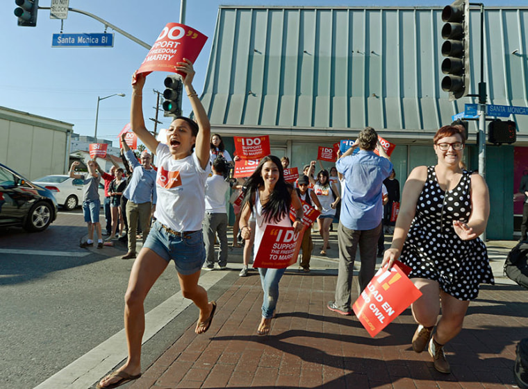People celebrate in the street after the Supreme Court ruling at a watch party at Equality California, a non-profit civil rights organization that advocates for the rights of LGBT people in California, on June 26, 2013 in West Hollywood, California. ...