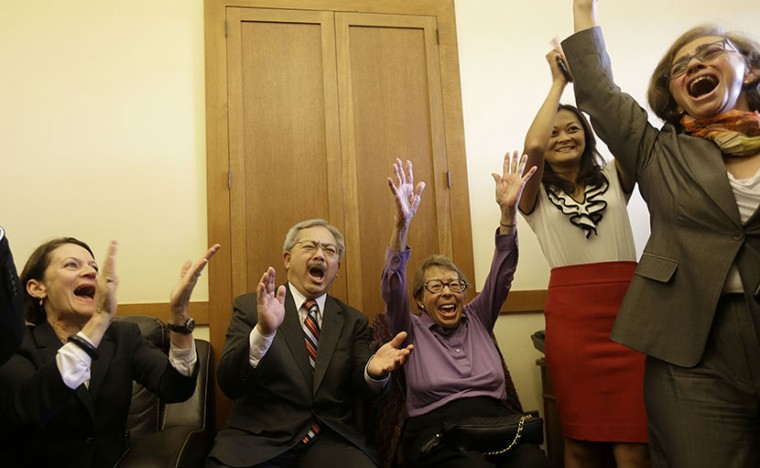 San Francisco Mayor Ed Lee, second from left, and Phyllis Lyon, center, celebrate with others after the Supreme Court cleared the way for same-sex marriage in California at the mayor's office at City Hall in San Francisco, Wednesday, June 26, 2013....