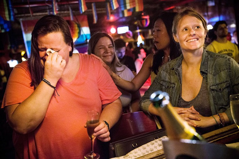 (L-R) Rachel Howald, Kate Lummus, Virginia Sin and Gretchen Menter celebrate after the Supreme Court ruled key portions of the Defense of Marriage Act (DOMA) unconstitutional, at the Stonewall Inn on June 26, 2013 in the West Village neighborhood of...