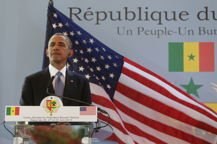 U.S. President Barack Obama listens to a question during a joint news conference with Senegal's President Macky Sall (not pictured) at the Presidential Palace in Dakar June 27, 2013. (Photo by Gary Cameron/Reuters)