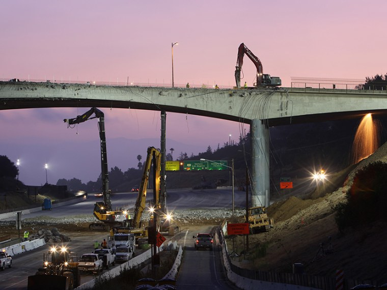 Workers demolish the south side of Mulholland overpass on the 405 freeway during the 53-hour total freeway closure resulting in massive traffic disruptions expected throughout the region on July 16, 2011 in Los Angeles, California.  (Photo by David...