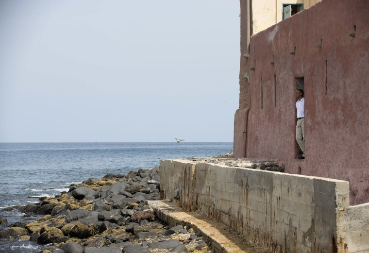 """President Barack Obama looks out of the """"door of no return"""" during a tour of Goree Island, Thursday, June 27, 2013, in Goree Island, Senegal. Goree Island is the site of the former slave house and embarkation point built by the Dutch in 1776, from..."""