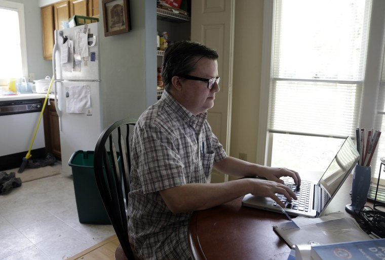 Lee Creighton looks for jobs on the Internet at his home in Cary, N.C., Thursday, June 27, 2013. Creighton has been unemployed since October and will receive his last bit of unemployment aid this week. (Photo by Gerry Broome/AP)