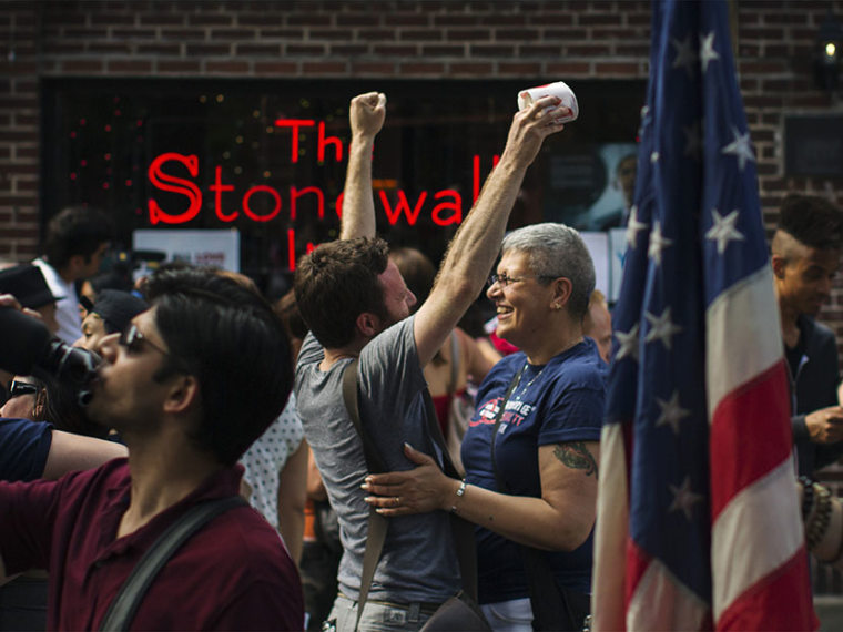 People embrace and cheer as they join a crowd celebrating the U.S. Supreme Court ruling against the Defense of Marriage Act outside the Stonewall Inn in New York June 26, 2013. (Photo by Lucas Jackson/Reuters)